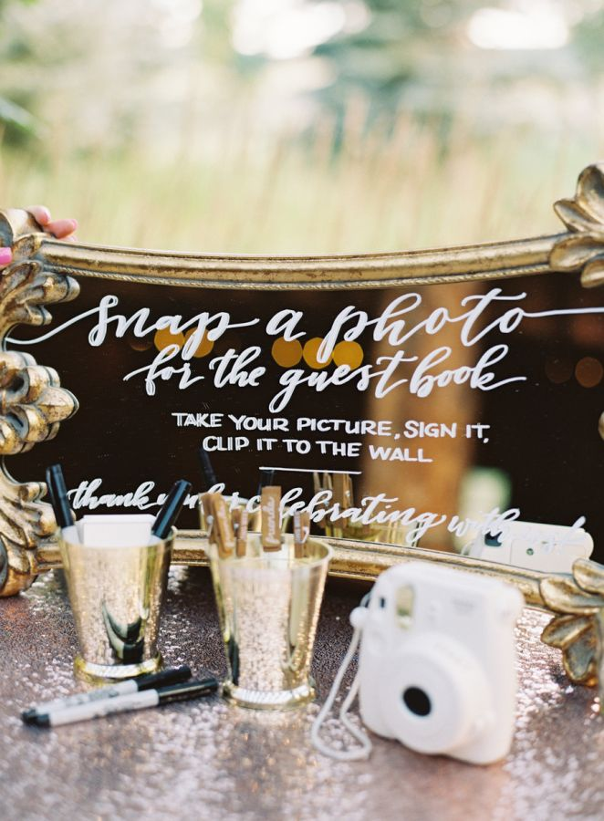 Interactive polaroid guest book: http://www.stylemepretty.com/colorado-weddings/2016/09/15/elegant-summer-colorado-ranch-wedding/ Photography: Carrie King - http://carriekingphotographer.squarespace.com/