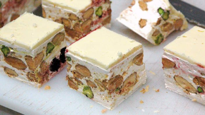 SBS ITALIAN: Soft nougat (torrone morbido) Set perfectly, with almonds, pistachios, cherries and a layer of white chocolate, you will never look at another nougat recipe again! You will need a sugar thermometer to make this recipe.