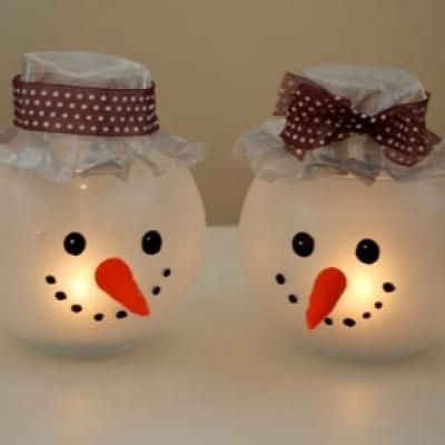 snowman. These are cute and would be easy to make. The blogger said she used small fish bowls and decorated them. Just be sure to use a battery operated flicker candle and not a wax candle : ) Enjoy!!