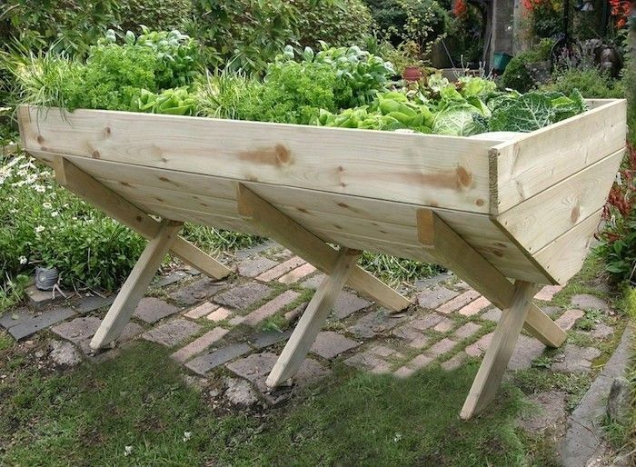 """Bring your gardening to new heights with an elevated planter box. """"Why,"""" you ask, """"a garden box on legs?"""" There are several benefits to an elevated p"""