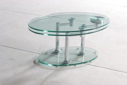 G8090 Oval Glass Coffee Table. This is a Tempered Glass Oval Coffee Table with the ability to swing around; opening its second layer.  A unique modern design coffee table that can be both compact and generous in size.