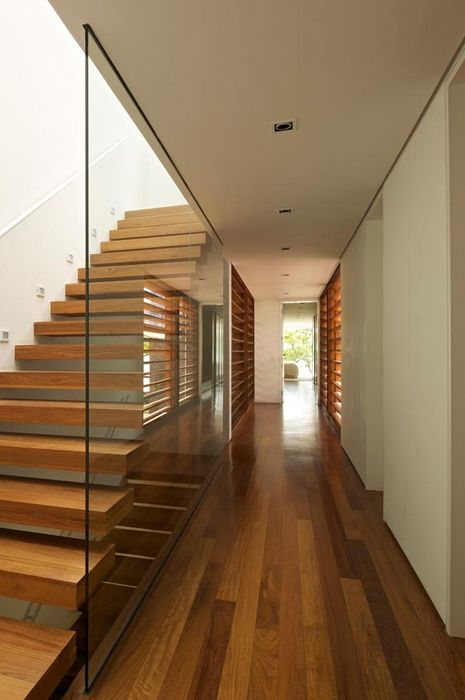 Hallway and wooden stairs in Modern beach house in Brazil
