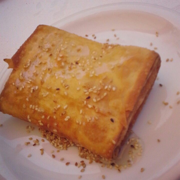 Feta cheese wrapped in phyllo pastry drizzled with honey and sesame seeds! Delicious! #greekfood #lefkada #φέτα  #λευκάδα #ελλάδα