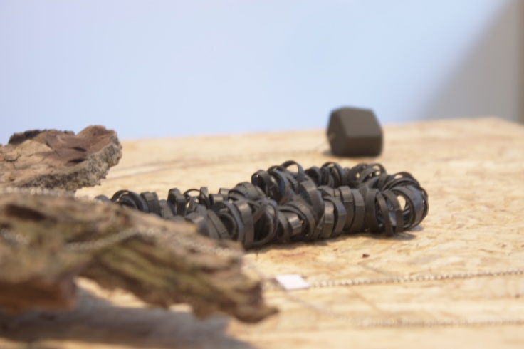Necklace, Tired Rings made of recycled bike tire by Tibbe Smith. Presented in the shop Designkollektivet next to a necklace by Nina Meldgaard.  Tibbesmith.com Designkollektivet.dk Ninameldgaard.dk