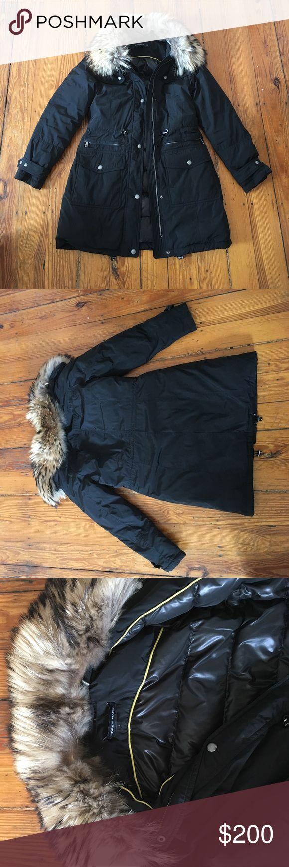 Andrew Marc black down parka with fur collar This Andrew Marc coat has kept me so warm through winter! It hits at mid-thigh to the top of the knees, depending on height. The fur collar is detachable and will keep your neck so warm! You don't need a scarf with the fur collar. It's real raccoon fur. The inside has a puffy lining. This is a black winter parka. Andrew Marc Jackets & Coats Puffers