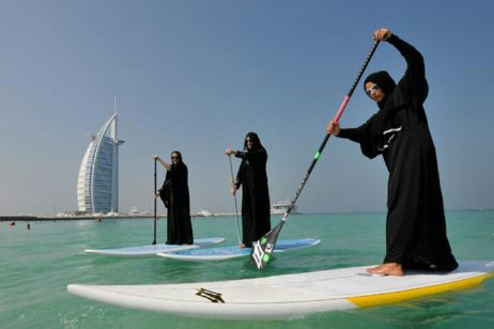 Only in Dubai, surfing in the abayas, nothing can stop them from enjoying this beautiful beach. Fun in the sun.
