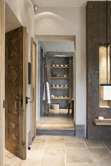 Love the door, the back shelf in dark cemento, styling objects and txtured ceramic floor.