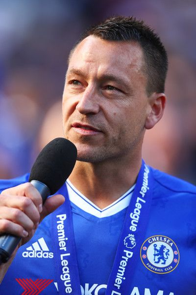 John Terry Photos - John Terry of Chelsea speaks to the Chelsea fans after the Premier League match between Chelsea and Sunderland at Stamford Bridge on May 21, 2017 in London, England. - Chelsea v Sunderland - Premier League