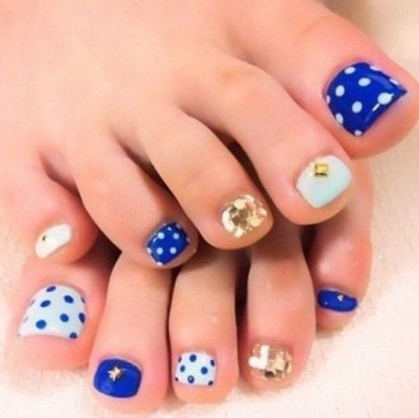 Blue Polish with Polka-dots, Glitter and Jewels Toe Nail Design.