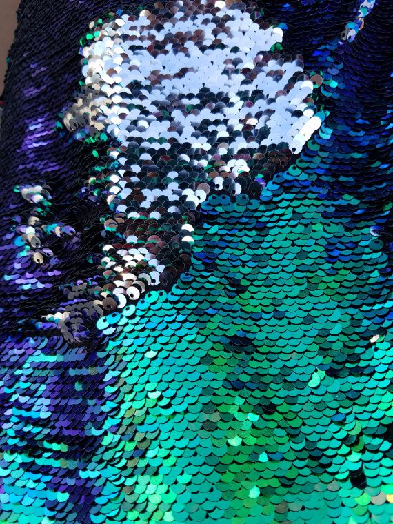 5mm Flip-Up Sequin Fabric by the yard. Colors are in listing Great for Gatsby look. Change the color of the fabric by just running your hands and flipping the sequin the opposite direction.  Measurements:  sequin size - 5mm  Fabric Width - 60 inch  Sequins Width -54 inch  Colors: Peacock/Silver we inspect our fabric before shipping.   CARE: Hand wash cold, do not wring, dry flat.  If you have any issue with fabric please contact us asap before cutting fabric. To issue a refund for fabri...