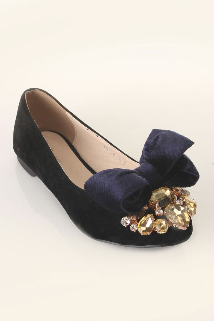 Navy Flats with a bow and some cute gems. This could be a DIY waiting to happen :)