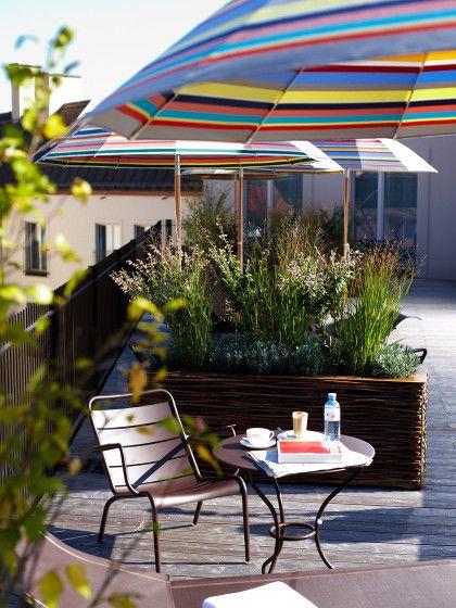 Die schönsten Rooftop-Bars in Deutschland. Hier die etwas versteckte Emiko Roof Terrace auf dem Dach des Louis Hotel in München.