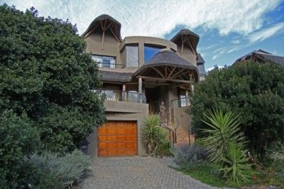 Offering an enchanting interior with open wooden beams and eye catching sandstone features that create an ambience of space and airiness. Situated in Wilderness Garden Estate with breathtaking views and private beach access.