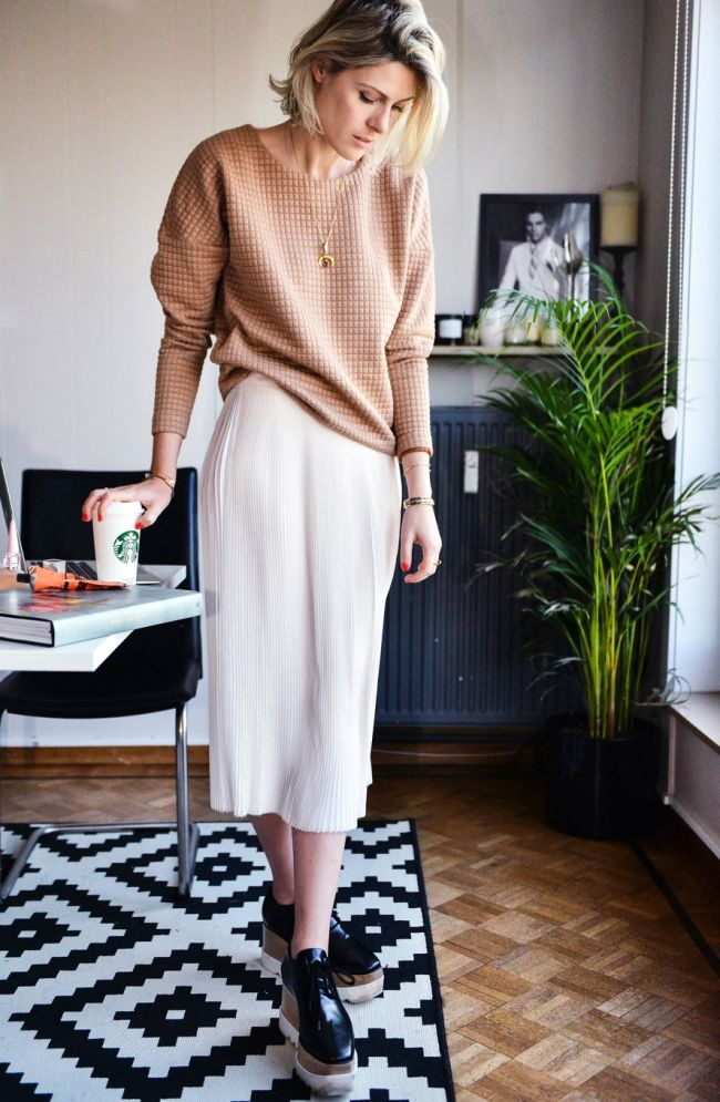 Sofie Valkiers Designers Remix sweater and pleated skirt ( available at ENES) Stella McCartney shoes Cartier Clou ring Frey Wille golden bracelet