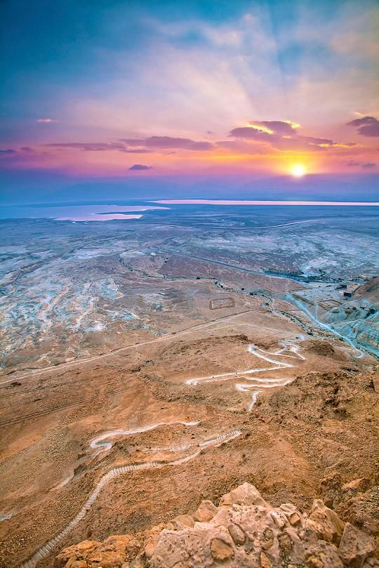 The sunrises in Masada, Israel are absolutely unreal.  You can catch them spanning over the Dead Sea after a little trek to the western edge of the Judean Desert.