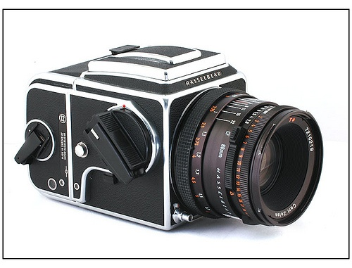 Hasselblad 500CM. My favorite film camera. The one I have was from the early 1980s and still going strong. Made in Sweden, all mechanical and uses German Carl Zeiss lenses with a 6x6 medium format square negative on 120 film. There is nothing like it. The rubberized cloth shutter sound is gorgeous.
