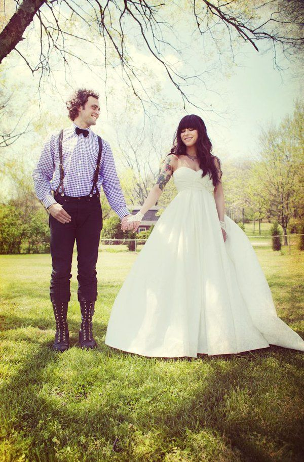bride with heavy bangs and a half sleeve of tattoos wearing a strapless wedding dress. I just want my tattoo before the wedding I think it would be beautiful with my dress...he's not for it :(