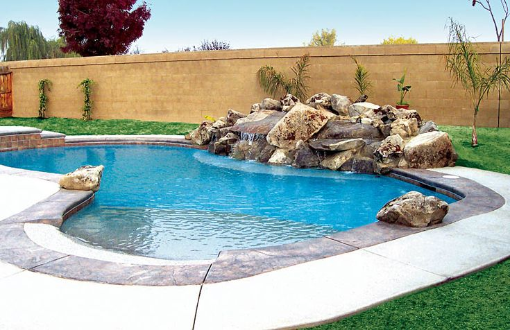 Beach Entry Pool with Rock Waterfall built by Blue Haven Pools