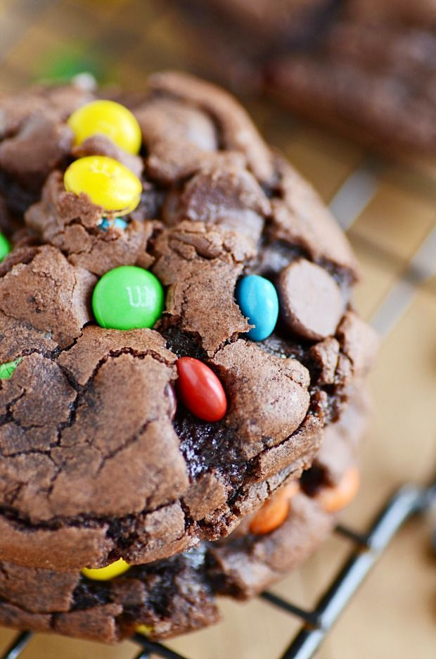Gooey chocolate insides and crackly tops make these brownie mix cookies the ultimate marriage of brownies and cookies. And SO easy!