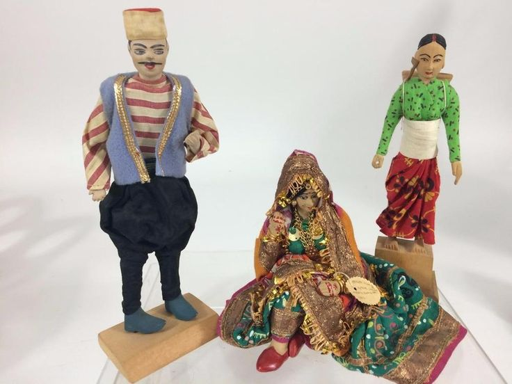Interesting additions to a vintage souvenir doll display. Bengal #IndiaBride  doll, ,#Nepal, and a Lebanon souvenir doll circa 1960's.