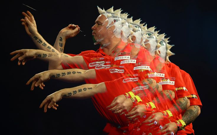 Peter Wright throws against Keegan Brown during the first round on day one of the 2016 William Hill PDC World Darts Championships at Alexandra Palace, LONDON, UK