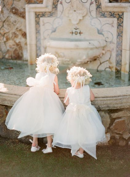 Flower girls in white dresses! So cute. {Photo by KT Merry via Project Wedding}