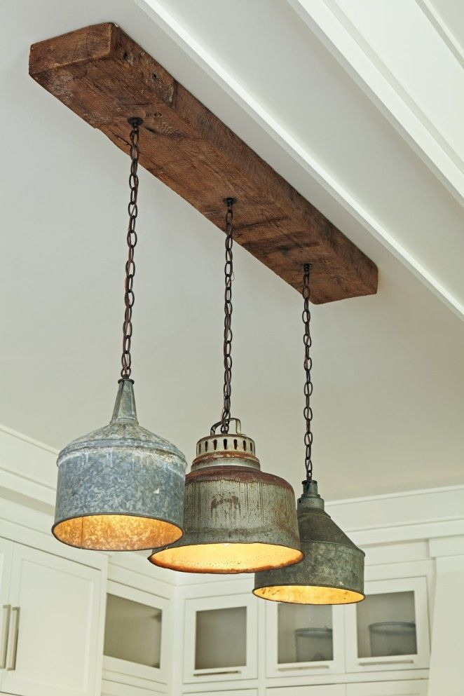 Salvaged tractor funnel chandelier - love the rustic wood eclecticallyvintage.com
