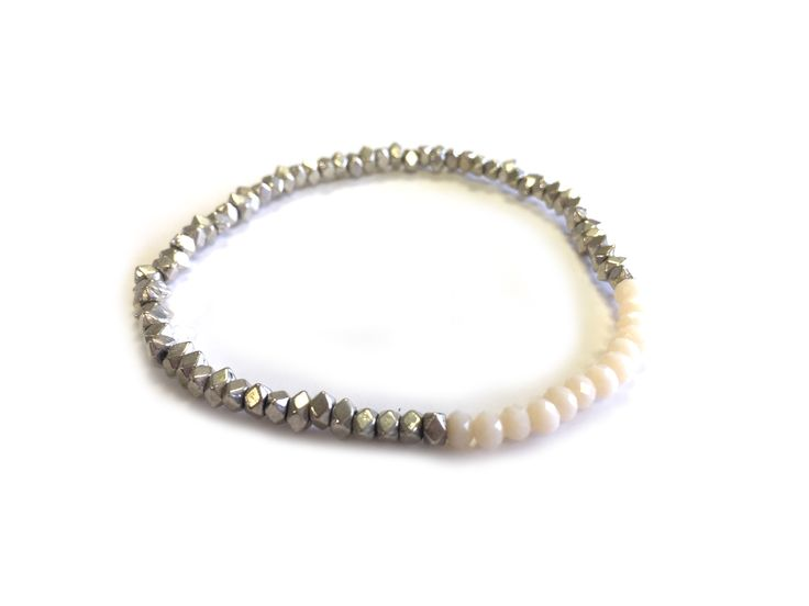 One Button bracelet - 1 line stretch silver nuggets & glass beads #milk #white #creamwhites #bracelet #accessories #onebutton Click to see more products from the One Button shop.