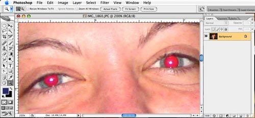 Removing red eyes using Photoshop.