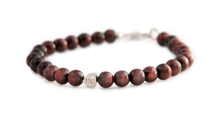 The Tiger Eye bracelet beads are part of the Quartz group, brown iron gives the stone its golden yellow color. It has a silky texture, and when cut into a cabochon, produces a shine reminiscent of a cat's eye.