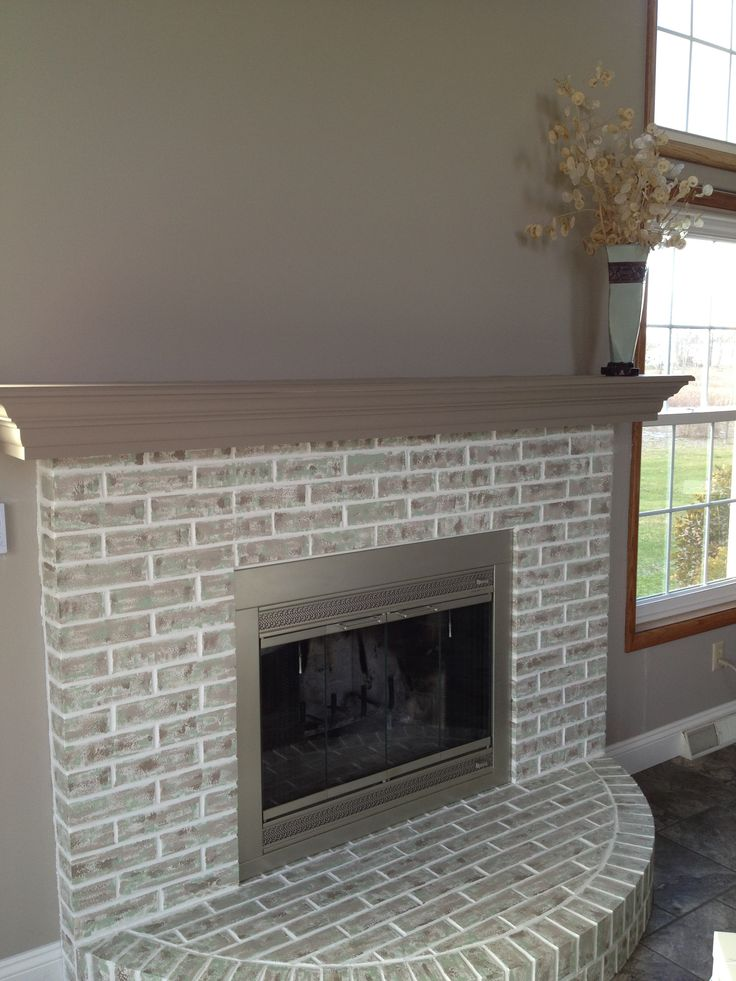Completed fireplace painted over red brick restoration for Brick designs