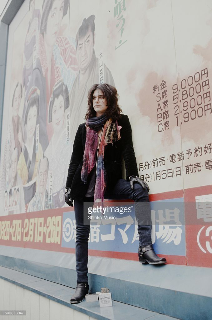 Gilby Clarke Guns N' Roses in front of theater signboard in Shinjuku, Tokyo, January 1992.