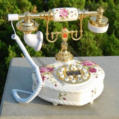Heart Shaped Antique Telephone with Flowers. How symbolic and appropriate!!!! I wonder if there's a place we can rent one