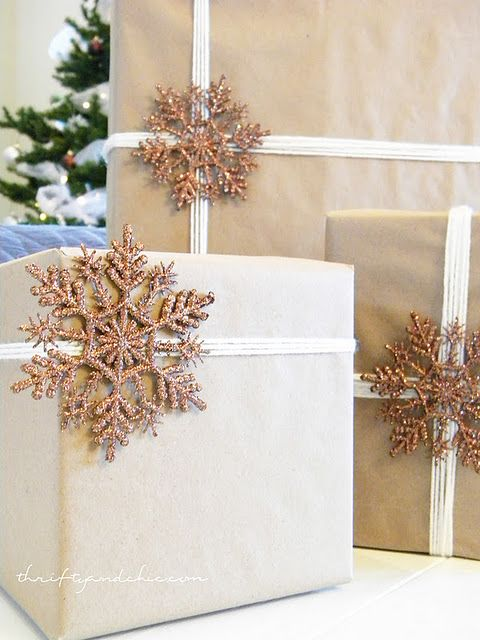 presents wrapped in brown craft paper with cream colored ribbon