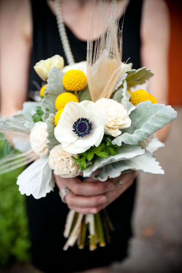 bouquet with anemone, billy buttons, and feathers // photo by CallawayGable.com