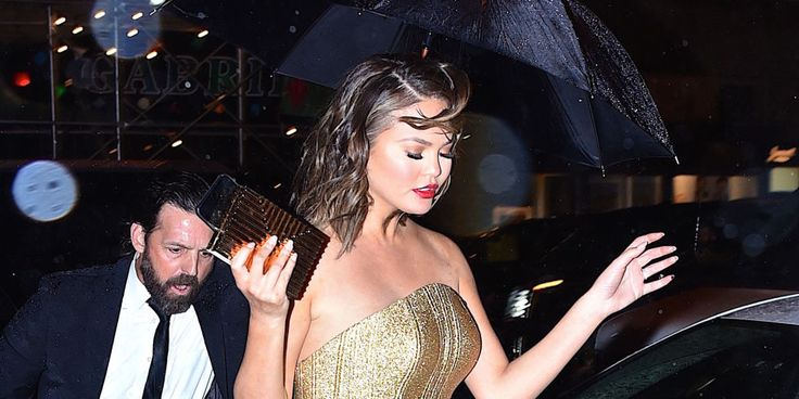 The model defied wind and rain to avoid a wardrobe malfunction.