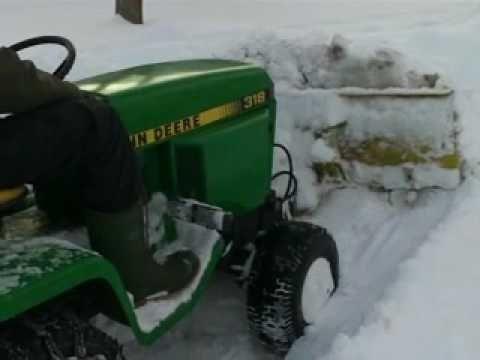 John Deere 318 Plowing Snow Blizzard Dec 2009