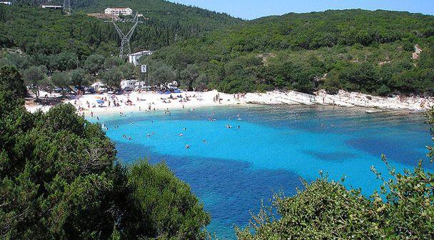 Foki beach - located in a bay full of cypress and olive trees, a very short distance from Fiskardo, Kefalonia. #Greece #Kefalonia #Terrabook #GreekIslands #Travel #GreeceTravel #GreecePhotografy #GreekPhotos #Traveling #Travelling #Holiday #Summer