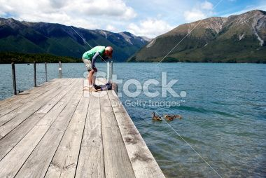 Man & Child on Jetty Royalty Free Stock Photo