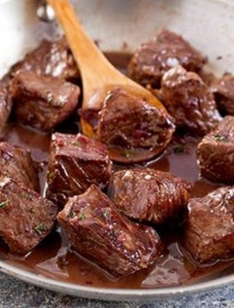 #Beef Tips with Red Wine Sauce recipe with yellow onion and mushrooms over Egg Noodles www.SevenSpringsWinery.com