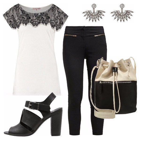Un total look bianco e nero semplice ed elegante con dettagli vagamente rock, quale il pizzo della maglietta, le zip sul pantalone e le scarpe a bande di pelle con fibbia. Ideale per il lavoro , ma ottimo anche per un aperitivo o una serata.