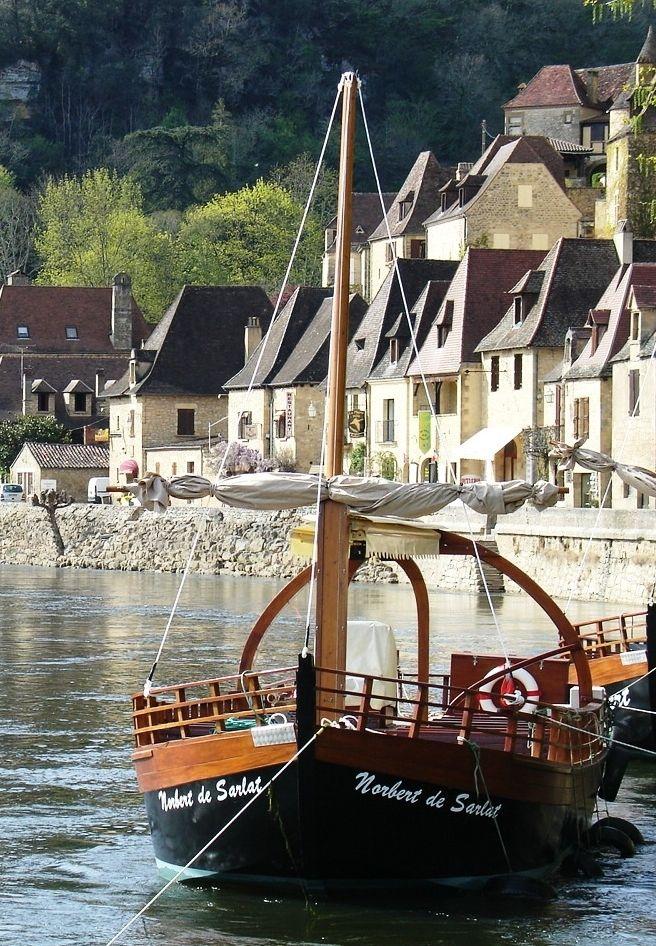 """La Roque-Gageac, Dordogne, Aquitaine, France - The Dordogne region is located just outside of Bordeaux. """"Une Gabare au file de l'eau """" Alison Laureen Weddings www.alison-laureen-weddings.com Wedding planner"""