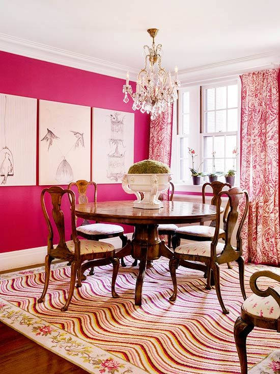 Making Waves Vivid hot-pink walls make this dining room a showstopper. To balance the intensity of the pink, simple artwork introduces wide swaths of white to the walls, while busier pattern appears in the textiles. Batik-print linen draperies and a bright needlepoint rug in an eye-fooling undulating pattern enliven the room, as does the pink, cream, and green brocade on the traditional Queen Anne chairs.