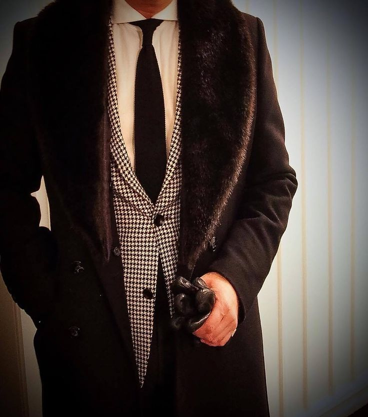 Coat with faux fur and matching blazer, tie and gloves.