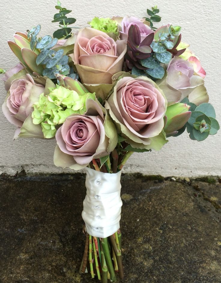 Wedding bouquet using Amnesia roses, hydrangea, baby blue eucalyptus.
