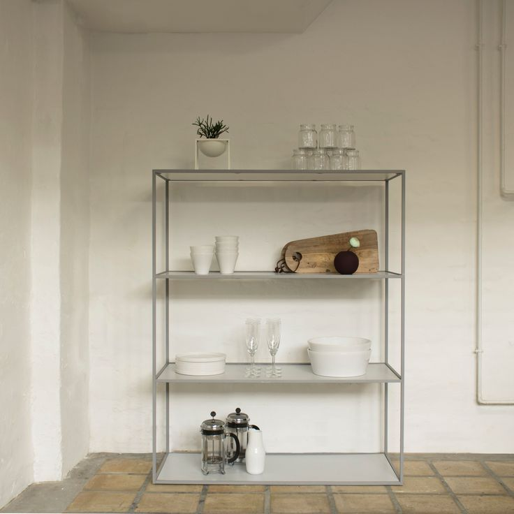 Twin bookcase in cool grey, Norli tableware in white and Kubus bowl in white.