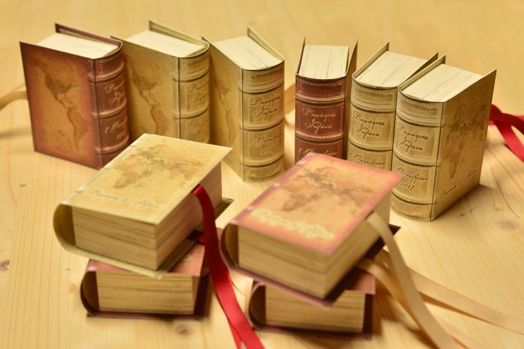 Old / antique books favor boxes with old maps - Travel themed wedding - Vintage wedding stationery - Beyond Verve