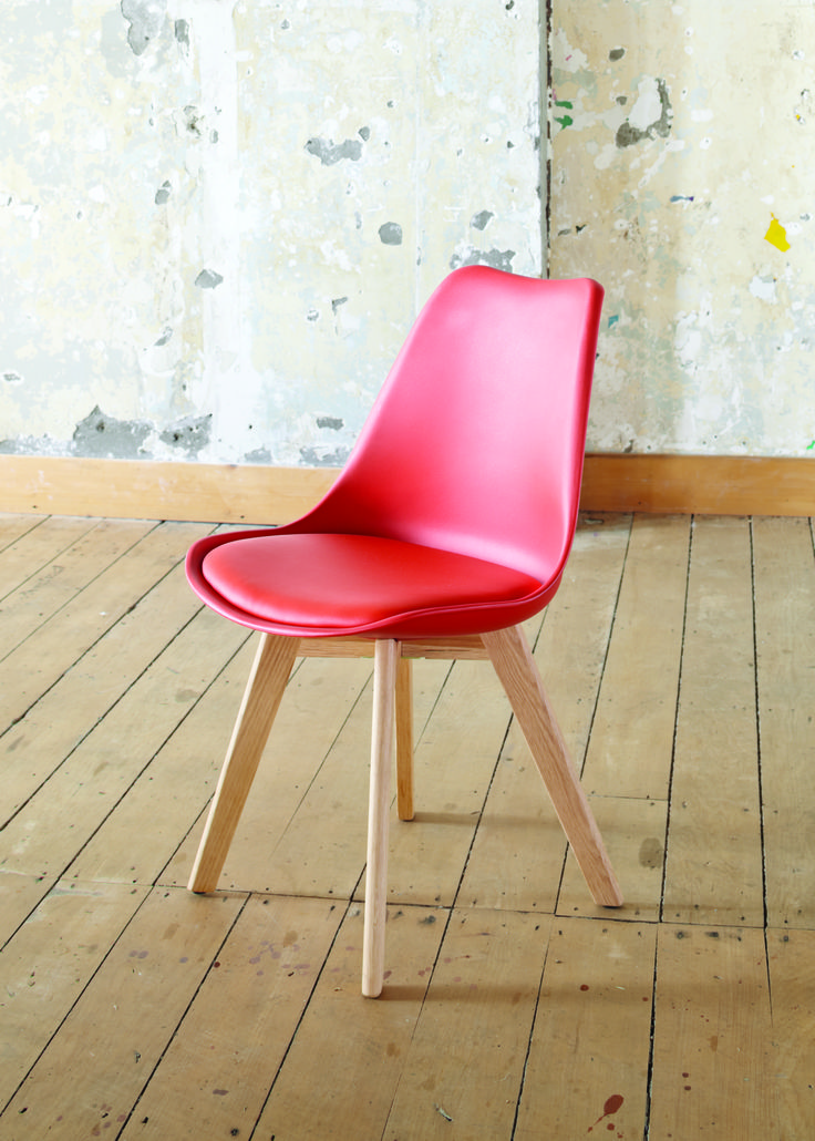 The Stuka Office Chair in red with retro style solid oak legs, plastic top and a padded seat insert. This chair also works well as a dining chair adding a splash of colour to your dining room.