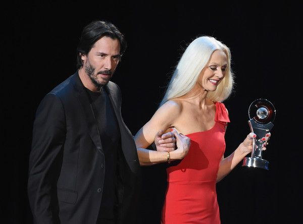 Keanu Reeves Photos Photos - Actor Keanu Reeves (L) accepts the Vanguard Award during the CinemaCon Big Screen Achievement Awards brought to you by the Coca-Cola Company at The Colosseum at Caesars Palace during CinemaCon, the official convention of the National Association of Theatre Owners, on April 14, 2016 in Las Vegas, Nevada. - CinemaCon 2016 - The CinemaCon Big Screen Achievement Awards Brought To You By The Coca-Cola Company - Show