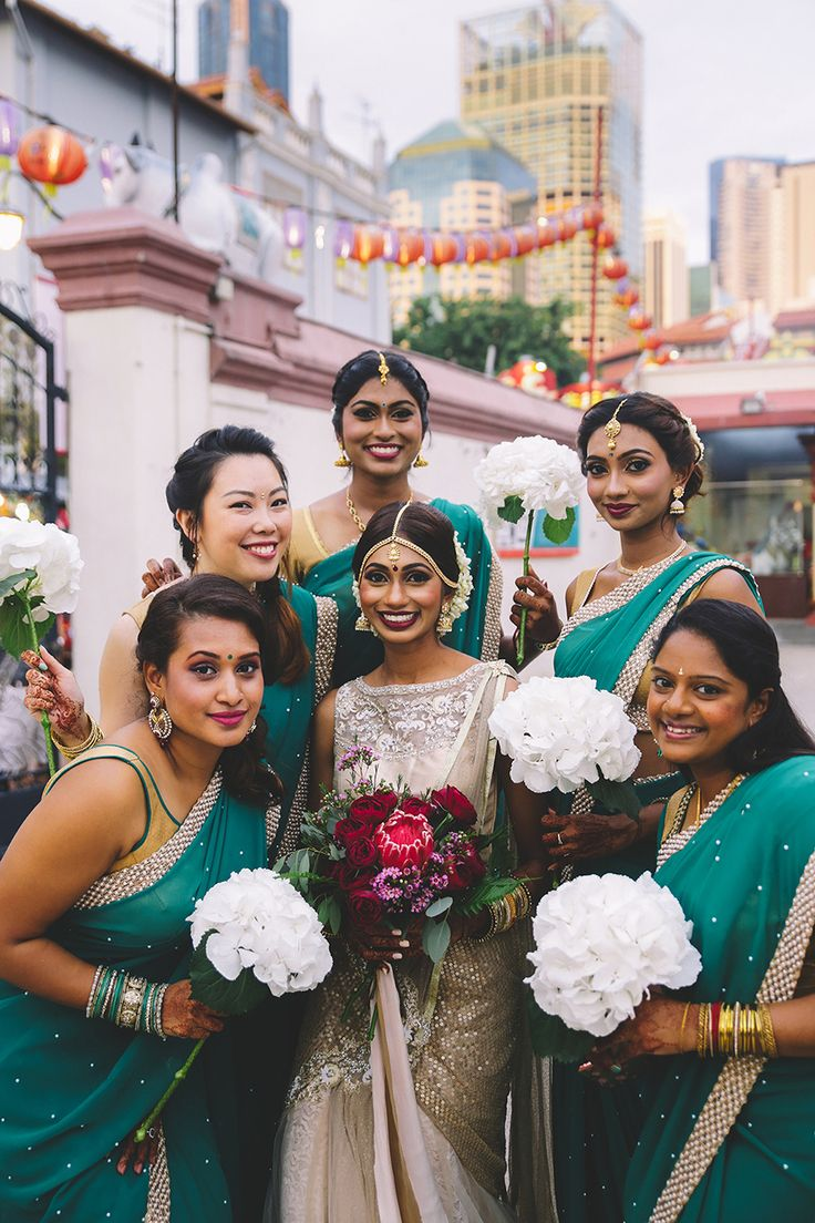 With Deepavali right around the corner, we thought it would be the perfect time to share bicultural couple Daryl and Hema's richly-hued wedding at the Sri Mariamman Temple, and dinner reception at Nosh, captured by Caline Ng Photography and Amdragan Studio respectively. The husband and wife team are floral designers from Bloomen and DIY-ed most of their wedding including props, styling, invitation cards and florals.